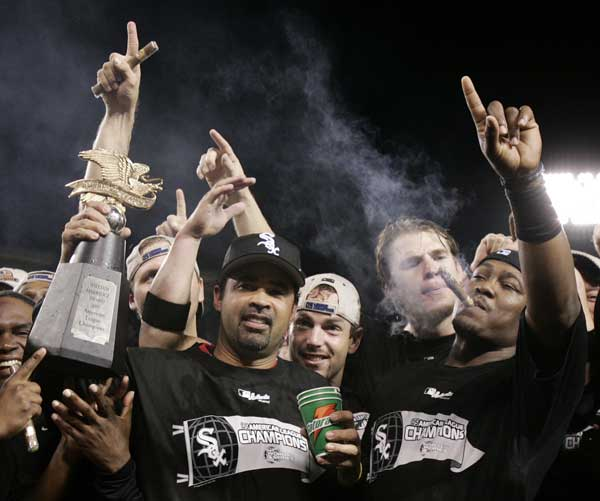 Chicago White Sox&#39; Juan Uribe, right, Joe Crede, second right, and Aaron Rowand, third right, celebrate with manager Ozzie Guillen, holding the American League Champiosnhip trophy, after they beat the Los Angeles Angels, 6-3, in Game 5 of the American League Championship Series, Sunday, Oct. 16, 2005, in Anaheim, Calif. The White Sox advance to the World Series.  <span class=meta>(AP Photo&#47;Kevork Djansezian)</span>